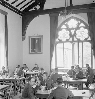 Norwich School (independent school) - American service personnel relaxing in the Bishop's Palace during the Second World War. Today the room is a sixth form common room.