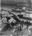 American twin-engine bombers, provided by lend-lease, are shown being hoisted aboard ship in an unnamed American port. - NARA - 196321.tif