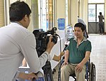 An ITTP alumnus talks to Vietnam News Agency Television about his experience with the training program and his current job. (14299402060).jpg