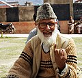 An old man voter showing mark of indelible ink after casting his vote, at a polling booth, during the 7th Phase of General Elections-2014, in Srinagar, Jammu & Kashmir on April 30, 2014.jpg