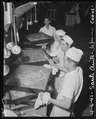 Arcadia, California. Cooks of Japanese ancestry prepare meals for thousands of evacuees at the Sant . . . - NARA - 537411.tif