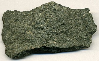 Metamorphosed basalt from an Archean greenstone belt in Michigan, US. The minerals that gave the original basalt its black colour have been metamorphosed into green minerals. Archean Greenstone Pillow Lava in Michigan USA 3.jpg