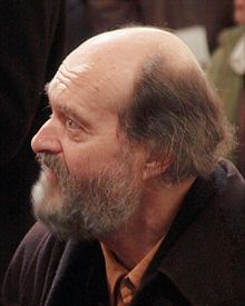 Arvo Pärt bearded balding man facing left