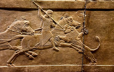 Assyrian king Ashurbanipal on his horse thrusting a spear onto a lion's head. Alabaster bas-relief from Nineveh, dating back to 645-635 BCE and is currently housed in the British Museum, London.jpg