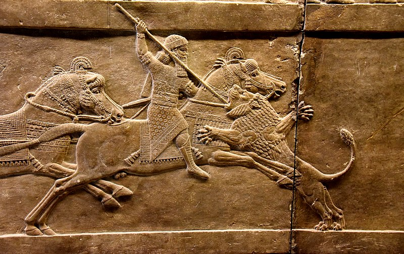 File:Assyrian king Ashurbanipal on his horse thrusting a spear onto a lion's head. Alabaster bas-relief from Nineveh, dating back to 645-635 BCE and is currently housed in the British Museum, London.jpg