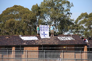 Australian immigration detention facilities - Asylum seekers on the roof of Villawood IDC, Sydney