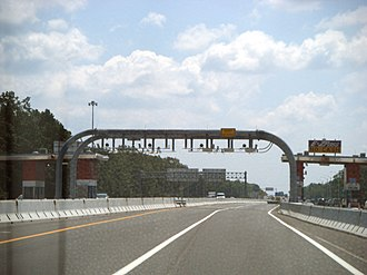 Open road tolling - E-ZPass Express lanes on the Atlantic City Expressway in New Jersey, which allows the motorist to pay their toll without stopping or slowing down.