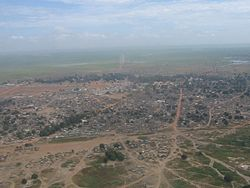 Aerial photo of Aweil (2007). Note the disused railway and long airport runway