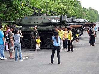 History of Thailand since 2001 - Supporters gathered to greet soldiers as tanks rolled into Bangkok.