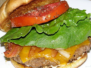 Cheeseburger with bacon, onion, romaine lettuc...