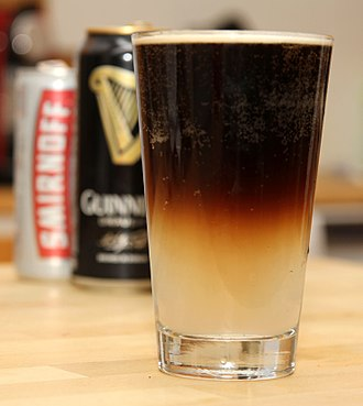 "Beer cocktail - A ""Badger"" cocktail, made from Guinness and Smirnoff Ice"