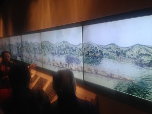 Baiheliang - Poster displayed at the Baiheliang Underwater Museum showing the configuration of the White Crane Ridge before the construction of the Three Gorges Dam