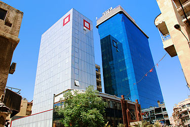 Bank Al-Sharq and the Blue Tower Hotel, a 4 star hotel in Hamra Street. BankSharqAndBlueTower.jpg