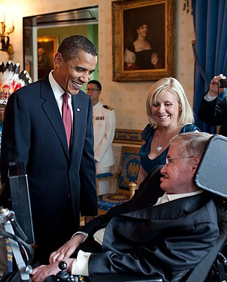 Stephen Hawking - President Barack Obama talks with Hawking in the White House before a ceremony presenting him with the Presidential Medal of Freedom on 12 August 2009.