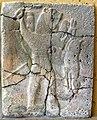 Basalt wall slab, relief, from Sam'al, Turkey, 10th-8th century BCE. Lion-headed man holding a rabbit. Pergamon Museum, Berlin, Germany.jpg