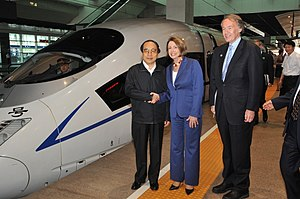 Liu Zhijun - Liu with Speaker Nancy Pelosi and Rep. Ed Markey, of the US House of Representatives in May 2009. Behind them is a high speed train on the Beijing–Tianjin Intercity Railway.