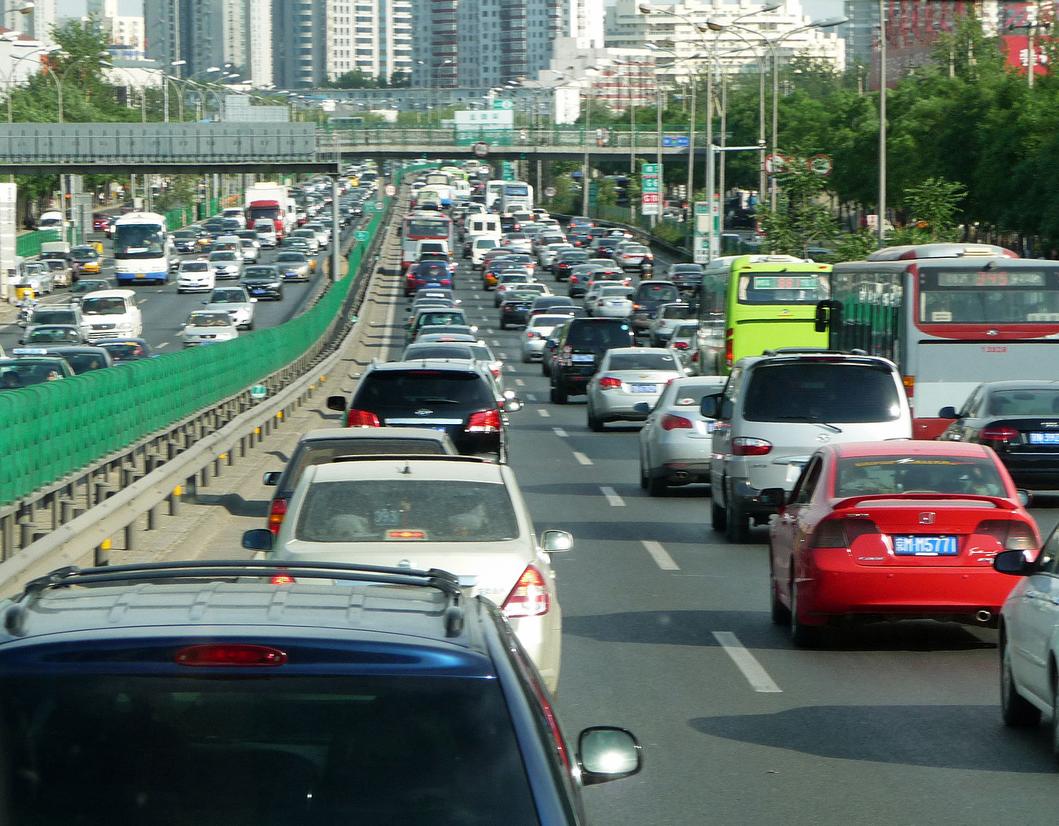 Continuity explains why traffic moves slower before a bottleneck than during the bottleneck. Wikimedia