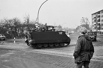West Berlin - In 1969 U.S. military vehicles pass through the residential district of Zehlendorf, a routine reminder that West Berlin was still legally occupied by the Western Allies of World War II