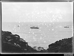 Black and white photograph taken from a headland depicting various vessels at sea, 1890-1953 (8587386805).jpg