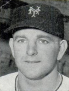 "A close-up of a man wearing a baseball cap with an ""NY"" on the cap."