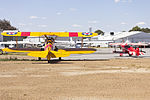 Boeing E75 Stearman (VH-SXT) and Pitts Special S1 (VH-BKG) parked in the general aviation area at Wagga Wagga Airport.jpg