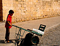 Boy selling ice in a sunny day at Al-Muizz street.jpg