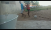 Boys battle for a ball in a backyard soccer game.png