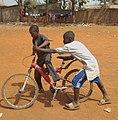 Boys riding bicycle.jpg