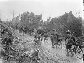 Army Cyclist Corps - British cyclist troops advance through Brie, Somme, 1917
