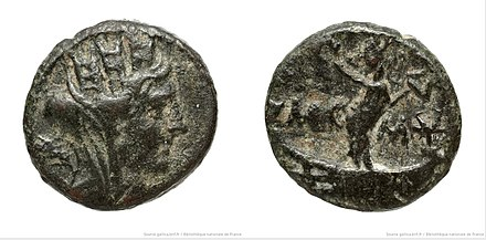 Bronze coin minted in Tyre during Hadrian's reign, with the head of Tyche (left) wearing a crown of towers and Phoenician goddess Astarte (right) BronzeCoinTyreRomanEmperorHadrian GallicaBNF.jpg