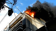 Building burning in Homs city