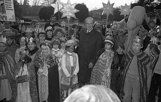 "Star singers - Epiphany singers are received by Germany's Federal President Karl Carstens in Bonn 1 December 1982. The poster reads: ""Dreikönigssingen 1983 AMANI. Damit Kinder heute leben können""."