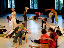 "Dancers move freely at a Contact Improvisation ""jam"""