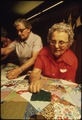 CLOSEUP OF SENIOR CITIZENS QUILTING IN NEW ULM, MINNESOTA THEY ARE ATTEMPTING TO KEEP THE OLD FRONTIER CRAFTS ALIVE.... - NARA - 558341.tif