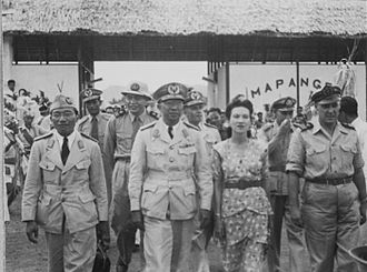 State of East Indonesia - President Tjokorda Gde Raka Soekawati of the State of East Indonesia and his French wife during a visit to North Celebes in 1948