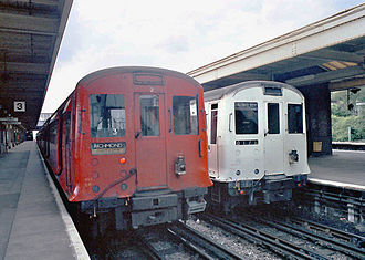 London Underground rolling stock - P stock in red with R Stock at Upminster
