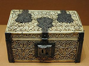 Casket - A casket made of ivory, wood with carved decoration and engraved silver.
