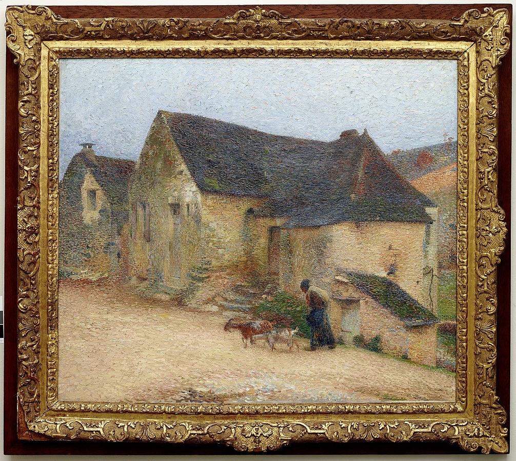 Chevrière devant une vieille maison à Labastide