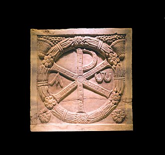 State church of the Roman Empire - Monogramme of Christ (the Chi Rho) on a plaque of a sarcophagus, 4th-century AD, marble, Musei Vaticani, on display in a temporary exhibition at the Colosseum in Rome, Italy
