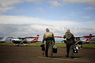 Civil Air Patrol - Two Oregon Wing members walk towards their aircraft during a training exercise.