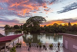 Colorful clouds with wooden terrace on the river banks of Si Phan Don, Laos, at sunrise.jpg