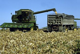 Screw conveyor - This combine harvester uses a screw conveyor within the tube to discharge grain into the trailer alongside