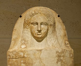 Phoenicia - Cover of a Phoenician anthropoid sarcophagus of a woman, made of marble, 350–325 BC, from Sidon, now in the Louvre.