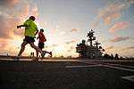 Crewmen on the aircraft carrier USS George H.W. Bush (CVN 77) run on the flight deck for exercise as the ship operates in the Atlantic Ocean on April 26, 2013 130426-N-YZ751-192.jpg