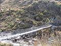 Crossing one of the last suspension bridges back to Syrabu Bese2.jpg