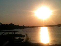 Sunset over Crystal Lake's namesake lake
