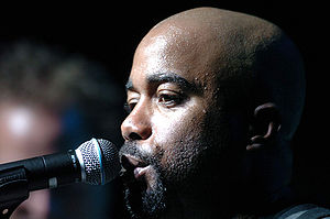 Darius Rucker - Rucker sings to a crowd during an Operation Pacific Greetings tour concert.