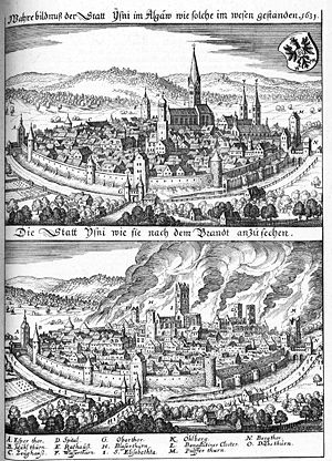 Isny im Allgäu - Isny before and after the great fire of 1631; St. George's Abbey church is the building with two spires to the right, with the rest of the monastery adjacent. Merian, Topographica Sueviae, 1643–56