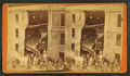 Debris and damaged buildings from explosion at the Curtis Hat Shop, by H. P. McIntosh.png