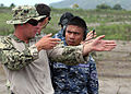 Defense.gov News Photo 120707-N-YU482-006 - U.S. sailors and Filipino service members discuss firing stance techniques during Cooperation Afloat Readiness and Training 2012 in General Santos.jpg